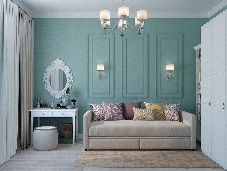A room of an apartment having a classic sofa, dressing table, and a cupboard