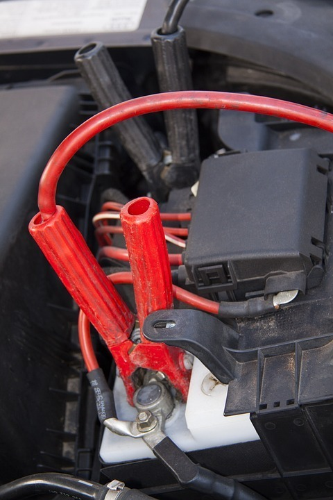 a close up of a jump start attached to a car battery